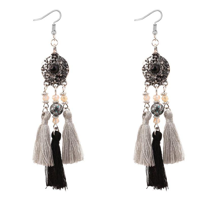 European and American vintage dial tassel earrings (black)NHNPS3138