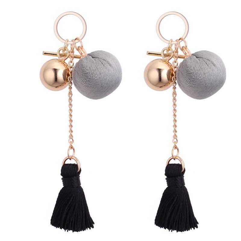 Korean fashion wild metal ball thread tassel earrings (black)NHNPS3233