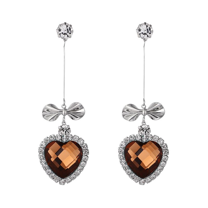 Korean version of the long sweet bow love rhinestone earrings smoke yellow NHNPS5431