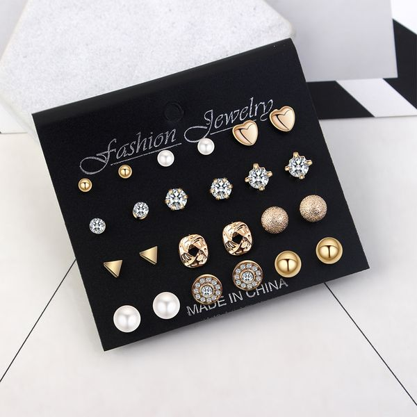 Korean version of the simple wild small ear kit (champagne alloy) NHNPS4464