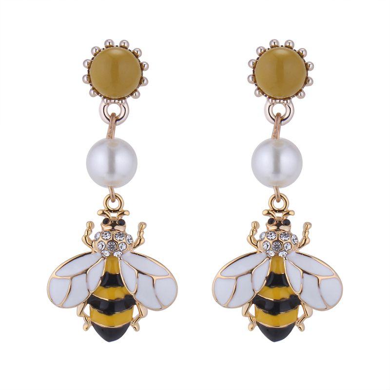 Korean version of the small fresh beads bee earrings NHNPS4772
