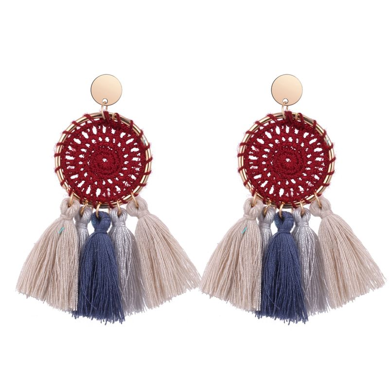 Korean version of the national wind knitted disc tassel earrings (purple red) NHNPS4819