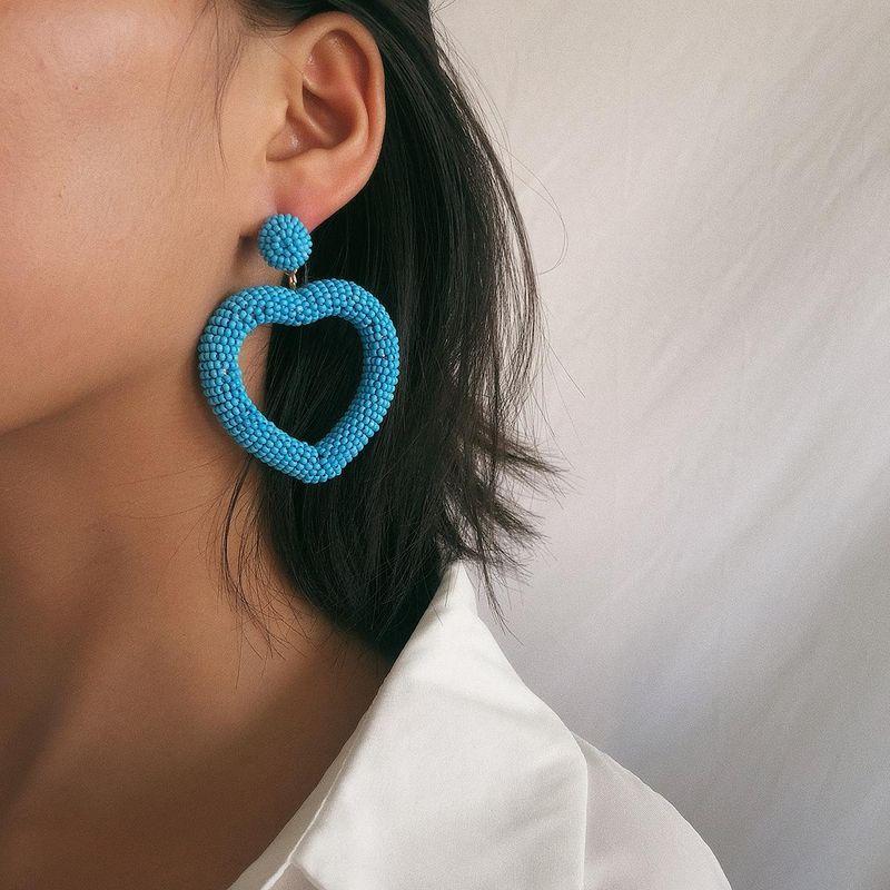 Creative heart-shaped cold wind rice beads earrings NHXR158243