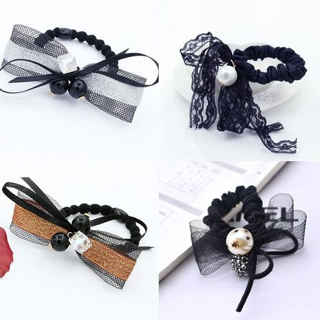Korean version of the pearl rose crystal diamond bow rope NHDP158289's discount tags