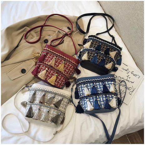 Korean version of the slung fashion weaving tassel shoulder bag NHXC170577's discount tags