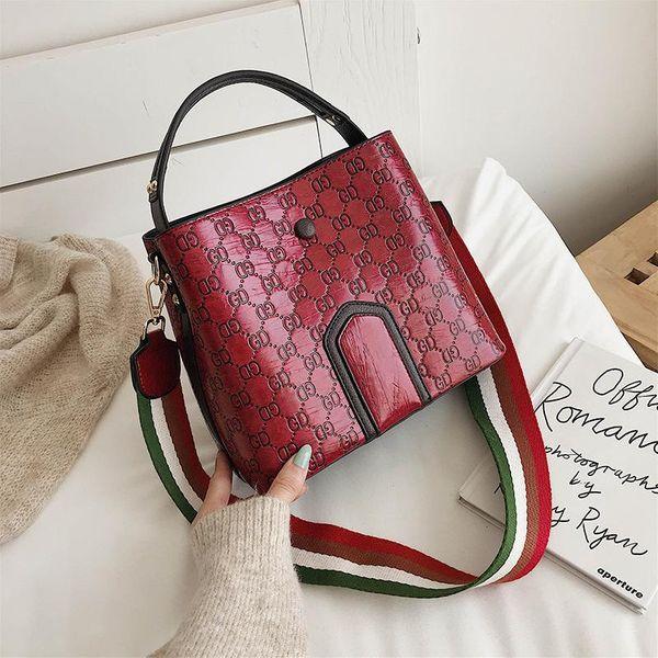 Fashion bucket bag new Messenger bag small fresh embossed fashion wide shoulder strap handbag NHTC170913