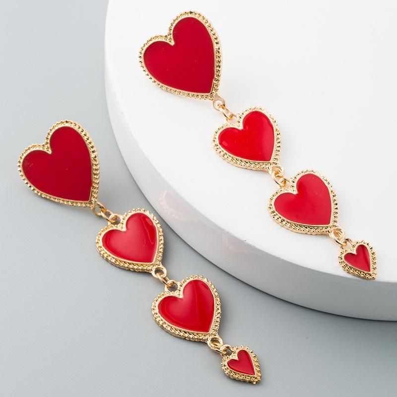 Creative fashion drip heart-shaped tassel alloy earrings NHLN171450