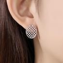 Retro hollow copper inlaid zirconium stud earrings NHTM172234