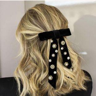 Moda temperamento arco borla perla piedras preciosas artificiales accesorios para el cabello NHWJ156845's discount tags