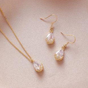 Fashion pop retro water drop zircon pendant necklace earrings personality shiny openwork flower ear hook NHMS177163's discount tags