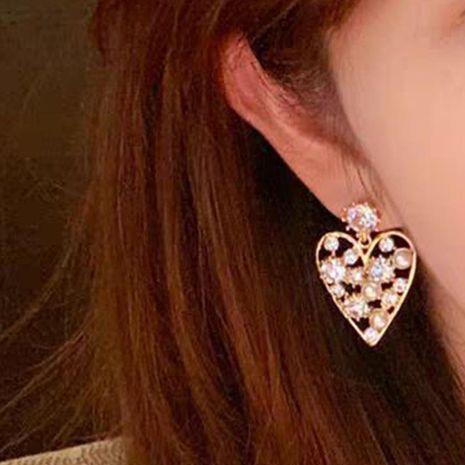 Pendientes de aleación de diamantes en forma de corazón pendientes creativos asimétricos hipster NHJQ177459's discount tags