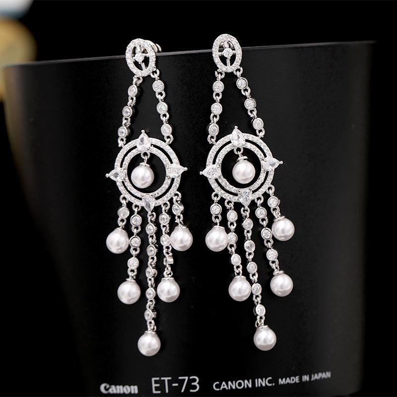 S925 silver needle Wang Hao with the same paragraph high-grade slim pearl earrings long tassel heavy work zircon earrings banquet wild NHDO177658