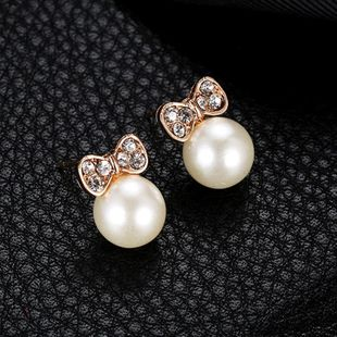 Korean fashion hot earrings simple temperament bow with diamond pearl studs NHDP178278's discount tags