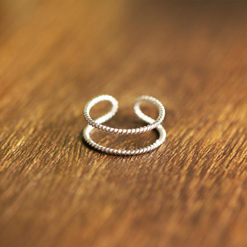 Korean version of the female retro double twist ring silver fine section ring open index finger tail ring color jewelry wholesale NHCU178296