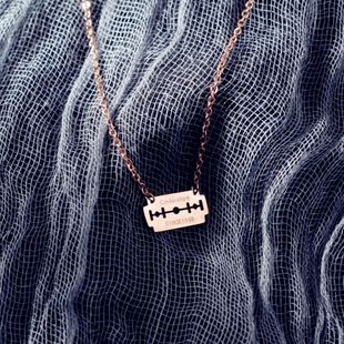 Korean fashion titanium steel 18K rose gold blade necklace NHIM178034's discount tags