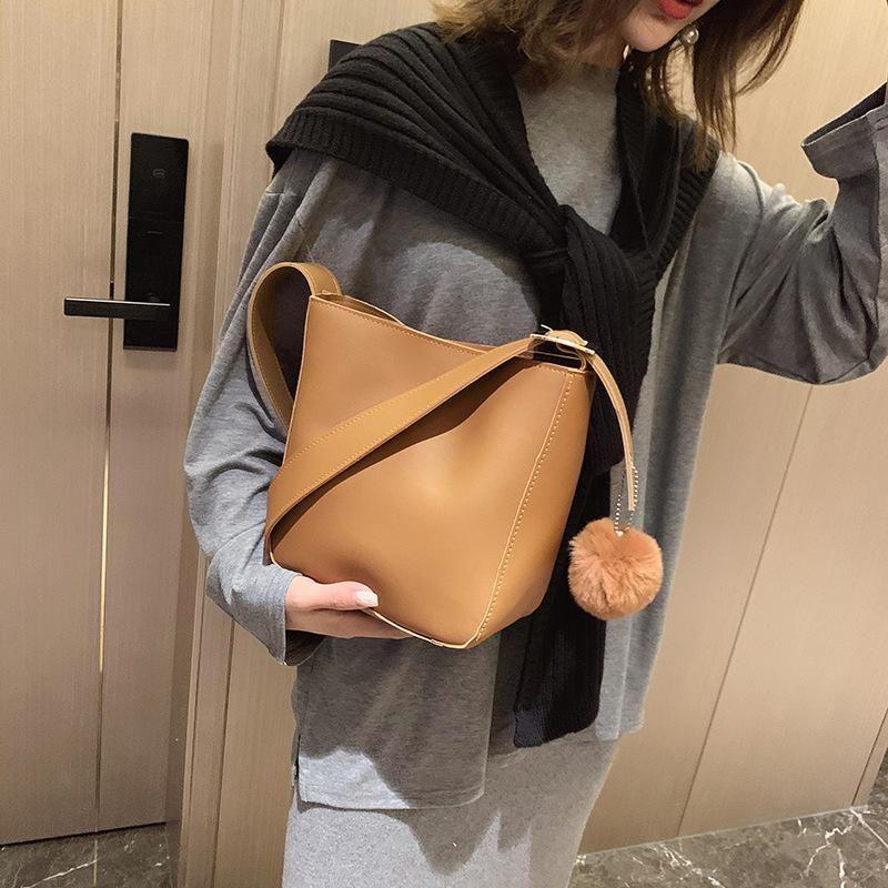 Bucket bag winter new fashion trend retro PU solid color bucket type women's shoulder diagonal bag handbag NHXC178887