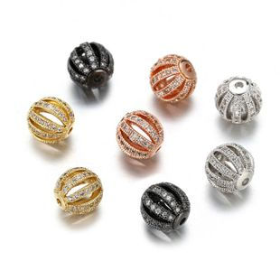 Moda creativa de cobre con incrustaciones de circonio hueco de cuatro colores redondos perlas sueltas colgante pulsera accesorios NHZU178831's discount tags