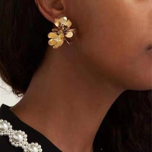 Alloy three-dimensional flower bright gold flower exaggerated earrings earrings wholesales fashion NHYQ179254's discount tags