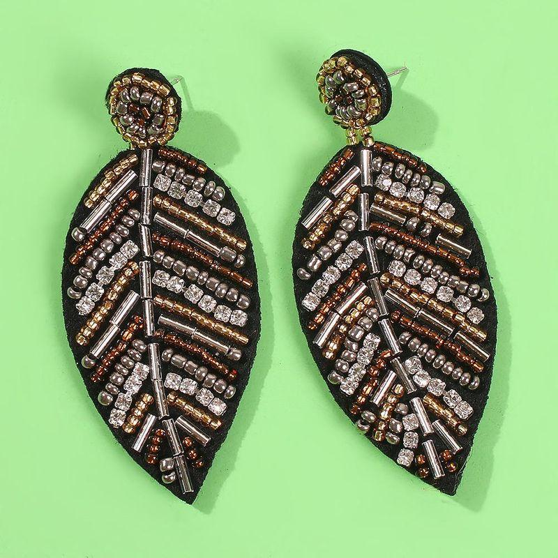 New Bohemian Creative Leaf Earrings Fashion Beizhu Leaf Handmade Earrings NHMD179077