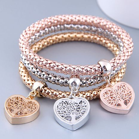 European and American fashion simple three-color love pendant three-color corn chain multi-layer bracelet NHSC180679's discount tags