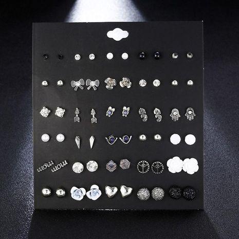30 pares de pendientes de perlas de búho plateados establecen joyería de moda al por mayor NHSD181477's discount tags