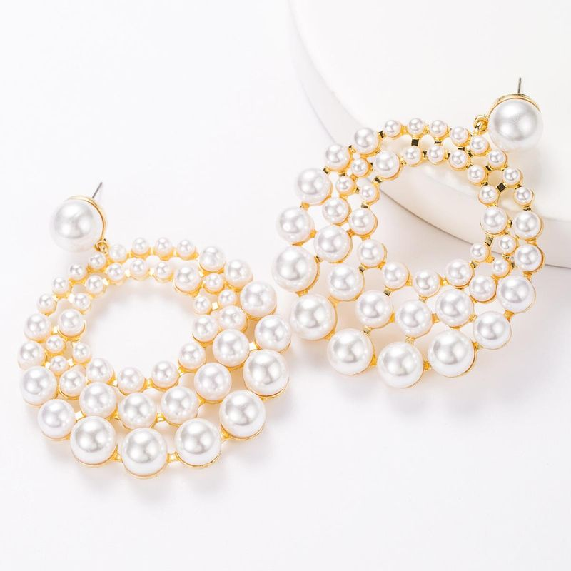 Multi-layer round alloy inlaid pearl earrings NHJE181679