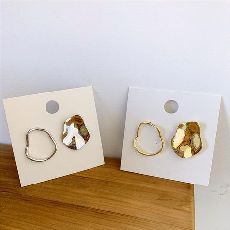 Korea Dongdaemun Metal Cold Light Shaped Glossy Stud Earrings NHYQ174982's discount tags