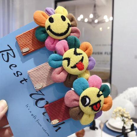 New children's cartoon cute plush color stereo sun flower smile face bangs bb hairpin women NHSM175239's discount tags