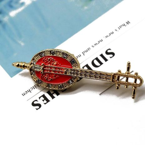 Exquisite red drip oil pin brooch instrument anti-lighting brooch oval pin NHOM176524's discount tags