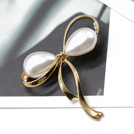 Bow pearl brooch pin openwork pattern brooch coat collar brooch NHOM176526's discount tags