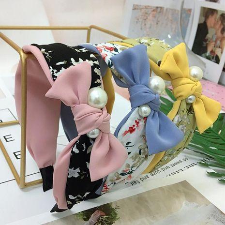Diadema de perlas con forma de lazo Diadema de accesorios de cabello floral de color antideslizante de borde ancho coreano diadema NHRH183244's discount tags