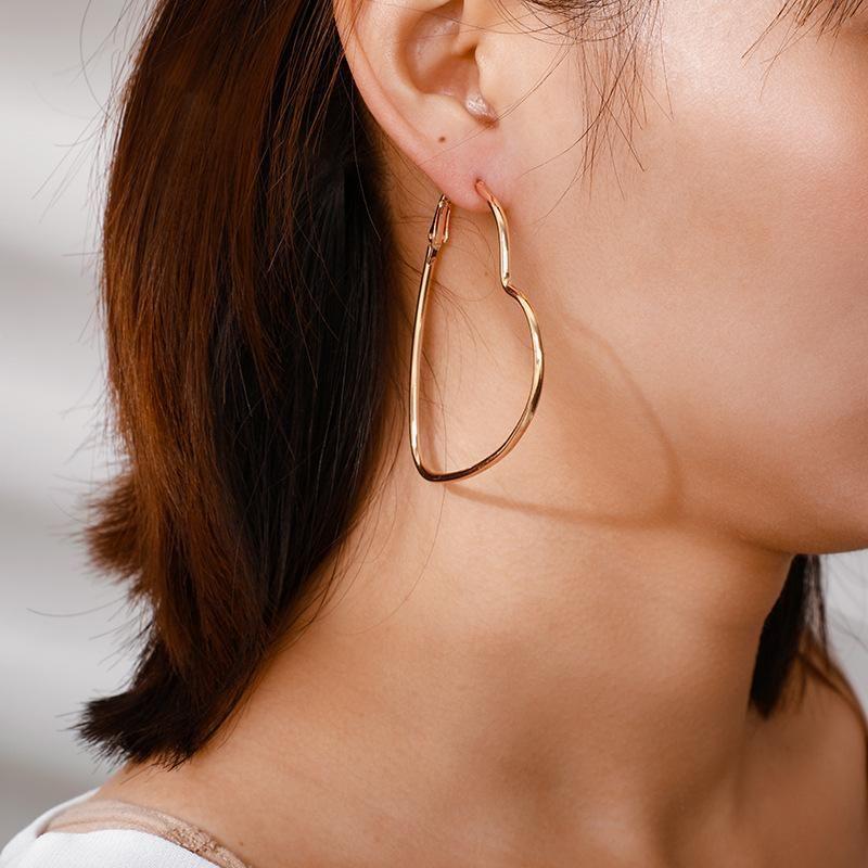 Alloy Joker Hollow Heart Stud Earrings NHGY185800