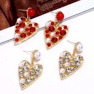 Fashion metal simple flash diamond peach heart temperament exaggerated earrings NHSC185761's discount tags