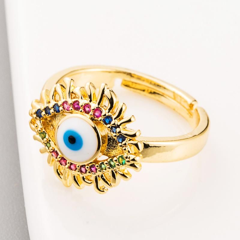 Hot selling personalized creative ring copper micro inlaid colored zircon devil eyes copper plated 18K gold female ring NHLN186088