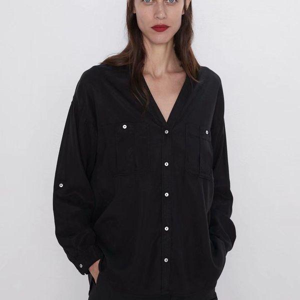 Camisa de cuello en V negra con bolsillo para mujer al por mayor NHAM186169