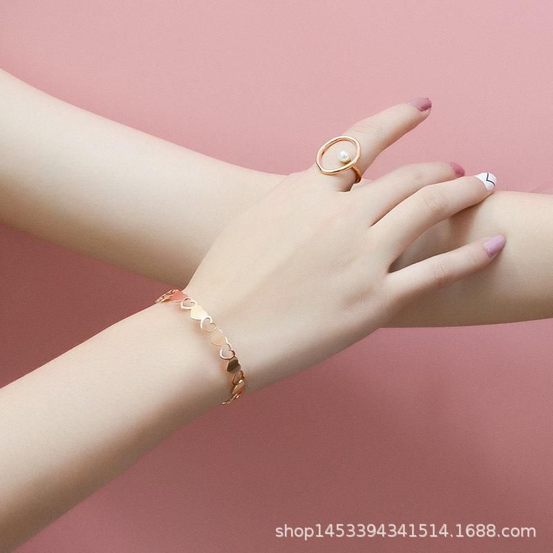 Simple atmospheric hollow peach heart Korean fashion bracelet titanium steel plated 18K NHOK186487