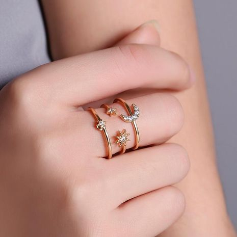 European and American fashion ladies ring three-layer hollow star moon ring personalized diamond pentagram opening ring NHDP187638's discount tags