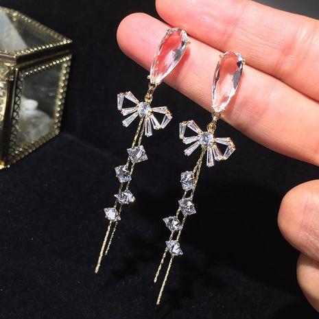 S925 Silver Needle Bow Long Tassel Earrings Round Face Earrings NHWK188633's discount tags