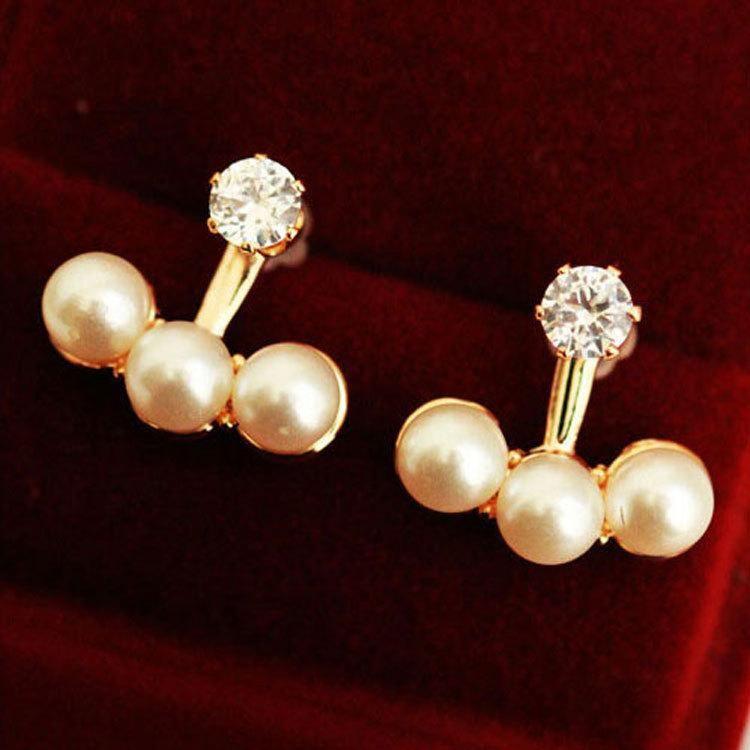 Three pearl stud earrings NHCU189026