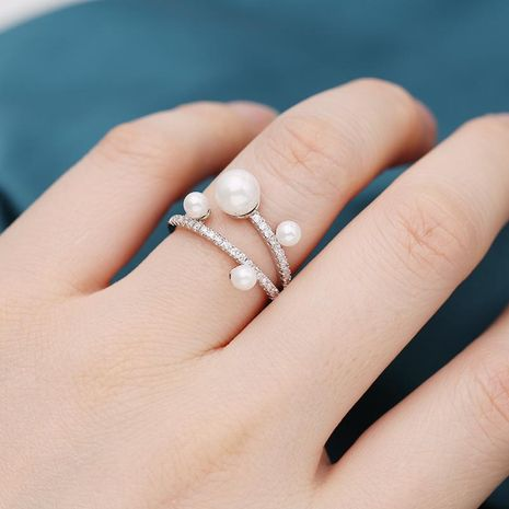 Hot Sale Copper Inlaid Zircon Pearl Ring Forefinger Simple Pearl Ring NHDO190047's discount tags