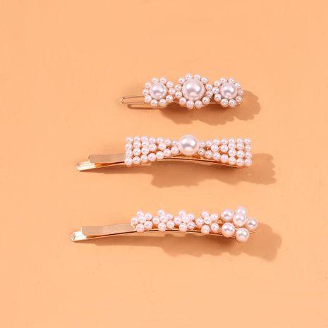 Nuevo clip para el cabello de perla Chica Dulce Accesorios para el cabello simples Clip de palabra Clip de borde NHMD190333's discount tags