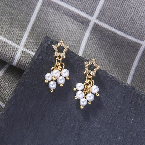 Hollow Star Stud Earrings Wild Star Moon Pearl Earrings wholesales fashion NHQD183892's discount tags