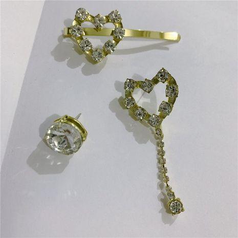 Pendientes de amor asimétricos de Corea Pinza de pelo Sweet S925 Silver Needle Full Diamond Heart Tassel Earrings NHYQ191075's discount tags