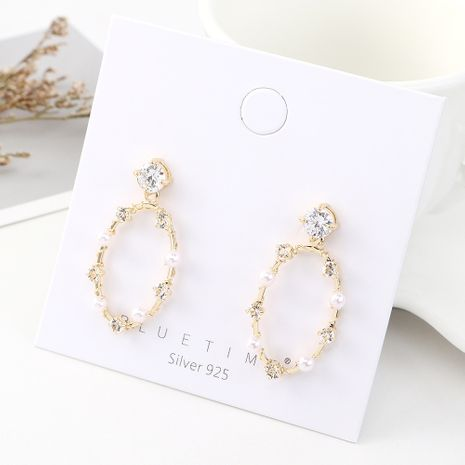 Korean version of simple and stylish temperament gold plated personality circle pearl hollow S925 silver needle NHPS185064's discount tags