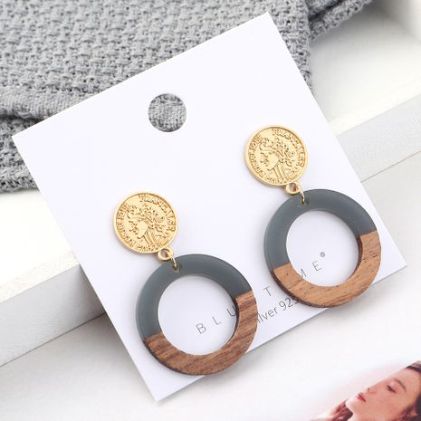 fashion earrings wholesale Real Gold Plated Frosty Wind Seal Circle Hollow S925 Silver Earrings NHPS185103's discount tags