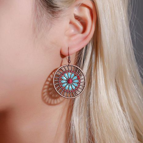 Earrings Creative Round Hollow Earrings Female Bohemian Fashion Retro Flower Earrings NHDP185741's discount tags