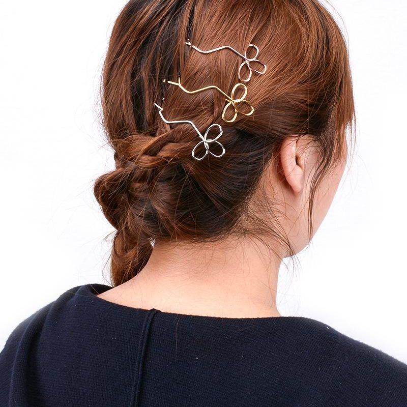 Accesorios para el cabello de metal trébol hueco hueco hecho a mano para mujer XR190430120068