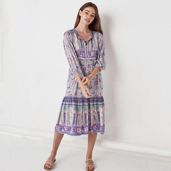 Fashion deep V-neck printed sling beach dress NHDF121880