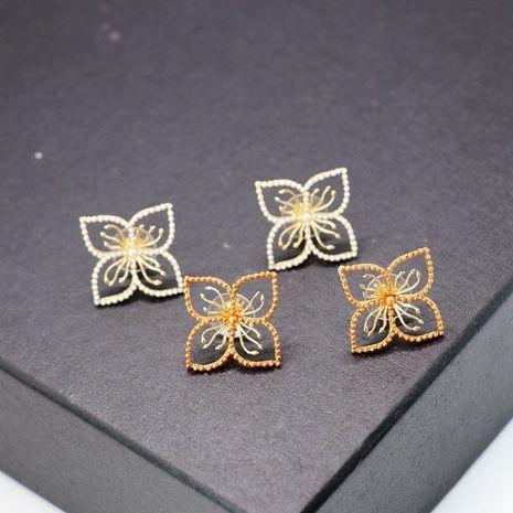 Copper hollow flower millet grain beads alloy needle stud earrings NHOM129455's discount tags