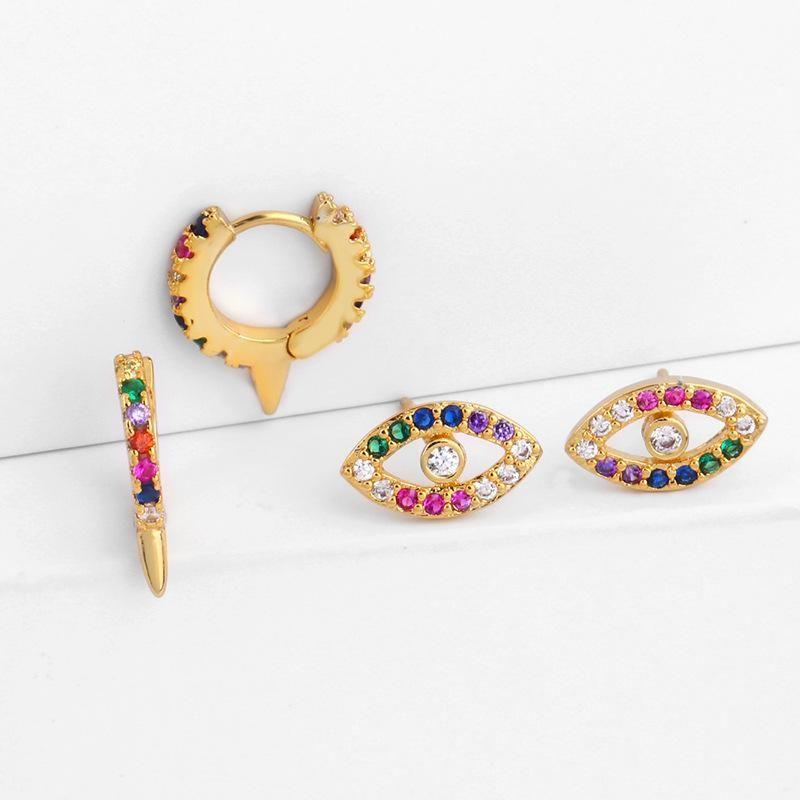 Womens Eye Brass Electric White Steel Earrings NHAS125351